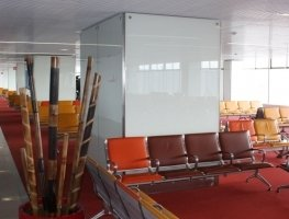 White painted glass wall covering for Orly aiport