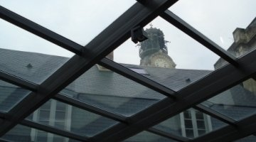 Safety & solar control glass roof for a passage