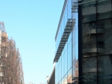 Solar control for a structural sealed glass facade