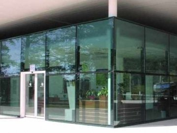 Structural sealed glass facade, partly sandblasted